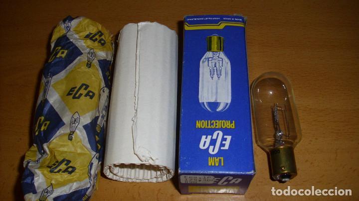 ANTIGUA LÁMPARA PROYECTOR ECA 125 300 CON CAJA BOMBILLA RECAMBIOS (Antigüedades - Técnicas - Aparatos de Cine Antiguo - Proyectores Antiguos)