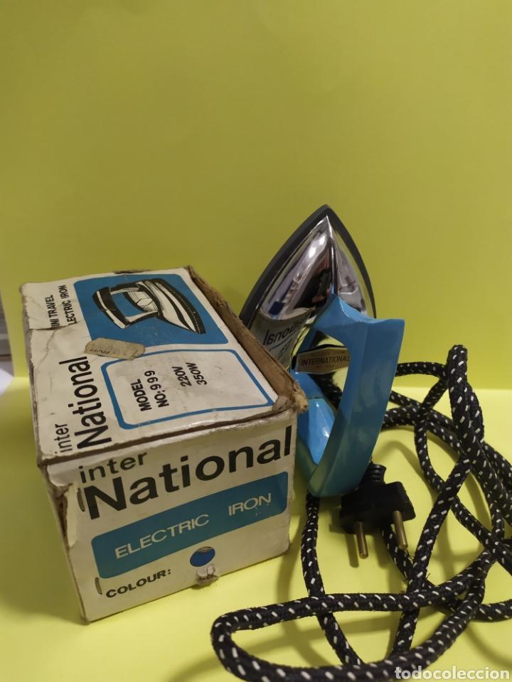 Antigüedades: Antigua plancha de viaje 14 cm , Marca International modelo 999 - Foto 11 - 201300178