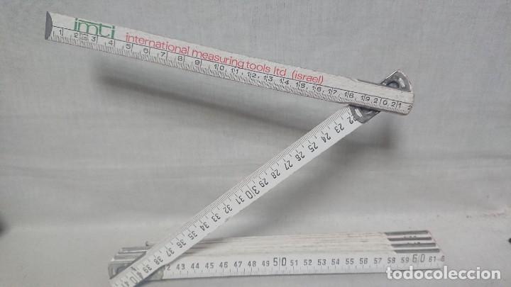 METRO DE CARPINTERO EN MADERA PUBLICIDAD IMTI - INTERNATIONAL MEASURING TOOLS ITD - ISRAEL (Antigüedades - Técnicas - Herramientas Profesionales - Carpintería )