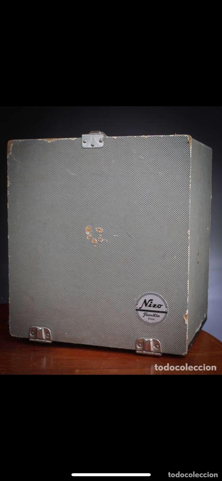 Antigüedades: Proyector Nizo Familia 8mm incluye caja y bombilla de repuesto - Foto 17 - 215303211
