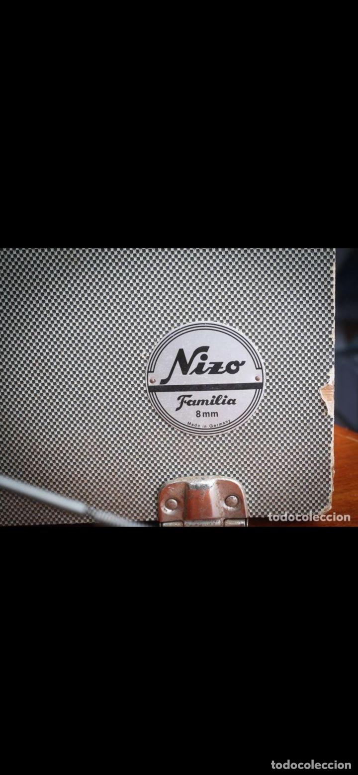 Antigüedades: Proyector Nizo Familia 8mm incluye caja y bombilla de repuesto - Foto 27 - 215303211