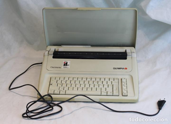 Antigüedades: Máquina de escribir eléctrica Olympia,modelo Carrrera,años 80/90,En perfecto estado,con estuche - Foto 2 - 216524272