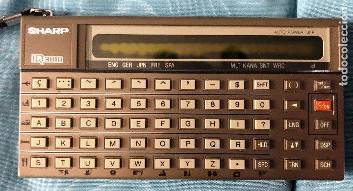 Antigüedades: Antigua calculadora SHARQ IQ3100, con su funda - Foto 3 - 279378793