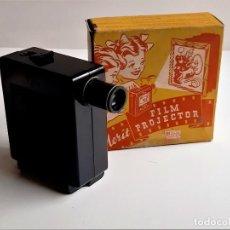 Antiguidades: MERIT FILM PROYECTOR + TIRAS DE PELICULAS EN INTERIOR - 11 X 11.CM - DE PASTA EN CAJA ORIGINAL. Lote 285314498