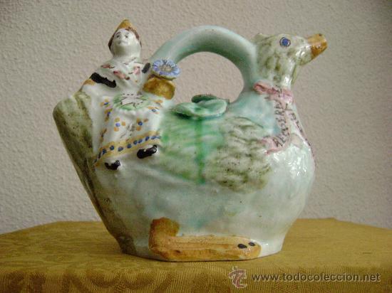 BOTIJO VALENCIANO.NIÑA SENTADA SOBRE UN PATO (Antigüedades - Porcelanas y Cerámicas - Otras)
