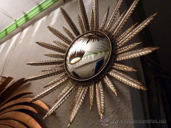 bonito espejo con forma de sol en laton