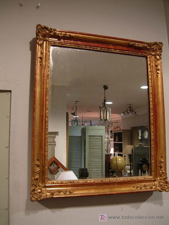 espejo dorado con pan de oro y bonitos adornos en los cantos siglo xix