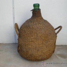 Antigüedades: DAMAJUANA-GARRAFA FORRADA CON TRENZADO DE ESPARTO, 16 LT., IDEAL DECORACIÓN. Lote 26909497