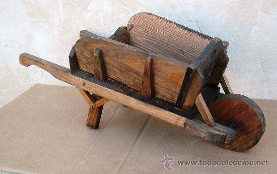 Carretilla de madera tallada jardin jard comprar for Carretilla de madera para jardin