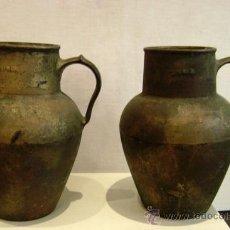Antigüedades: PAREJA DE JARRAS EN HIERRO FUNDIDO. Lote 31339234