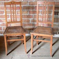 Antigüedades: 2 SILLAS ANTIGUAS DE MADERA CON ASIENTO REJILLA Y REMATE RESPALDOS CON DETALLE EN MARQUETERÍA. Lote 36739024