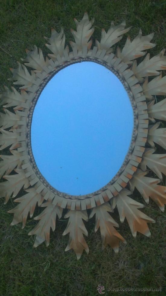 Bonito espejo ovalado forma de sol hierro dora comprar for Espejos en forma de sol
