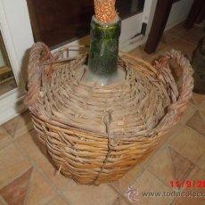 Antigüedades: GARRAFA O DAMAJUANA FORRADA DE MIMBRE . Lote 38976946