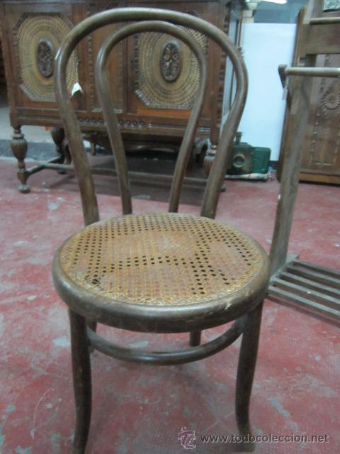Antigua silla baja de madera con asiento reji comprar - Restaurar sillas antiguas ...