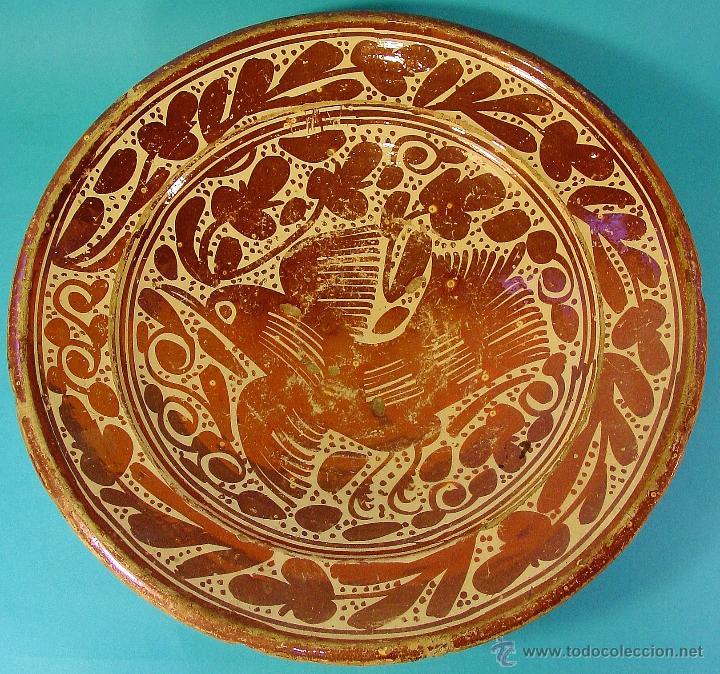 GRAN PLATO EN CERÁMICA DE REFLEJO METÁLICO, DECORADO CON PARDALOT. MANISES. SIGLO XVII. (Antigüedades - Porcelanas y Cerámicas - Manises)