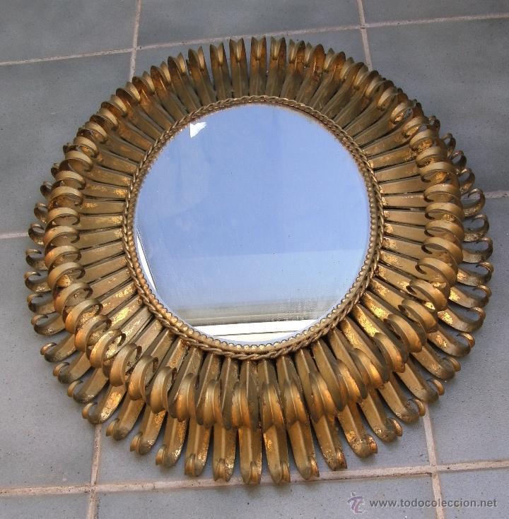 espejo de hierro en forma de sol ovalado de dos pisos xcm aprox de diametro aos aprox
