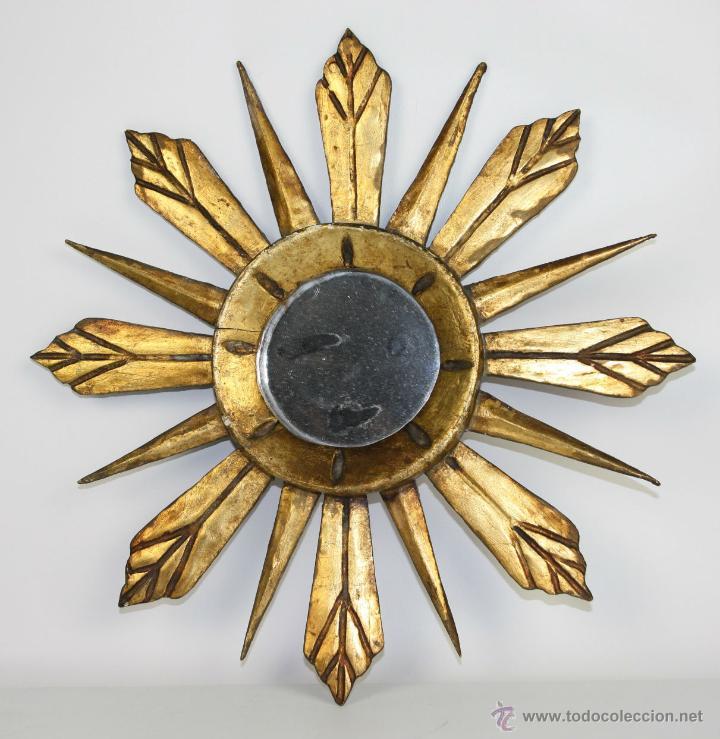 espejo en forma de sol en madera tallada y dorada aos