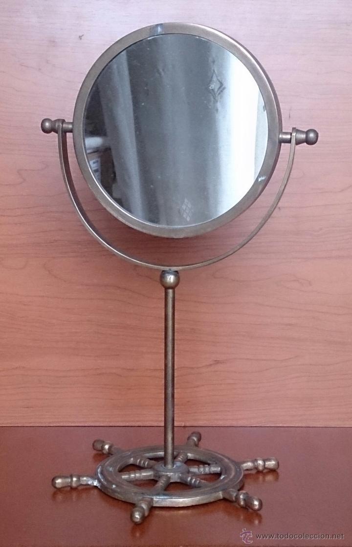 espejo antiguo y original en bronce con base en forma de timn de barco