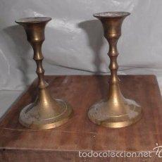 Portavelas de bronce