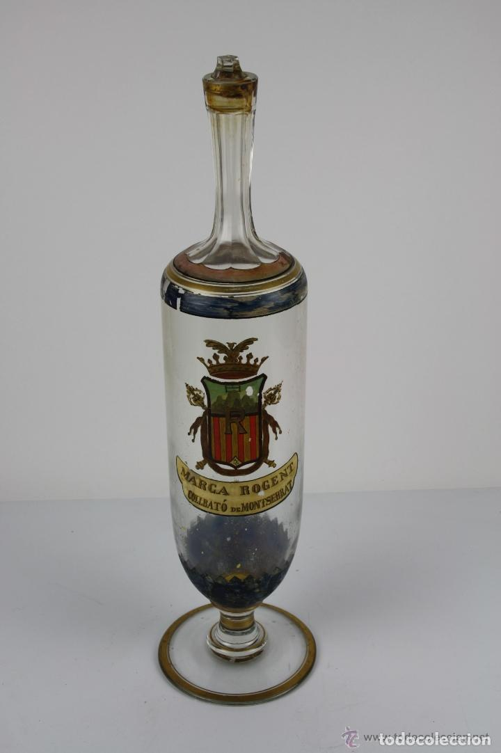 BOTELLA DE LICOR. MARCA DE LA FAMILIA ROGENT. COLLBATÓ. SIGLO XIX. (Antigüedades - Cristal y Vidrio - Catalán)