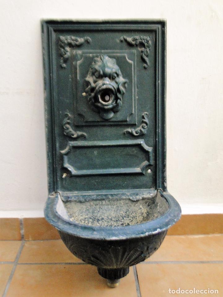 antigua fuente de jardn aluminio fundido para pared color verde oscuro busto pez mitologico