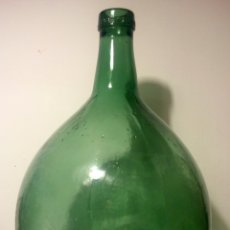 Antigüedades: BOTELLA DAMAJUANA GRANDE MARCA BARCELONA.. Lote 75994393