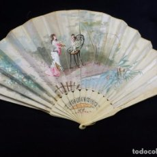 -Precioso abanico en hueso o marfil, con país de tela, pintado a mano: Dama. S XIX