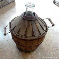 Antigüedades: GARRAFA DE VIDRIO FORRADA. Lote 86264672