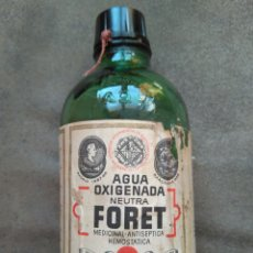 Antigüedades: ANTIGUA BOTELLA AGUA OXIGENADA, LABORATORIOS FORET BARCELONA. CON SELLO COLEGIO HUERFANOS.. Lote 91432988