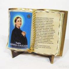 Antigüedades: ADORNO CON FORMA DE LIBRO EN BARRO COCIDO CON LA IMAGEN DE SANTA GEMA GALGANI. Lote 98842615