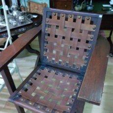 Antigüedades: BUTACA DE MADERA CON TIRAS DE CUERO. Lote 110041987