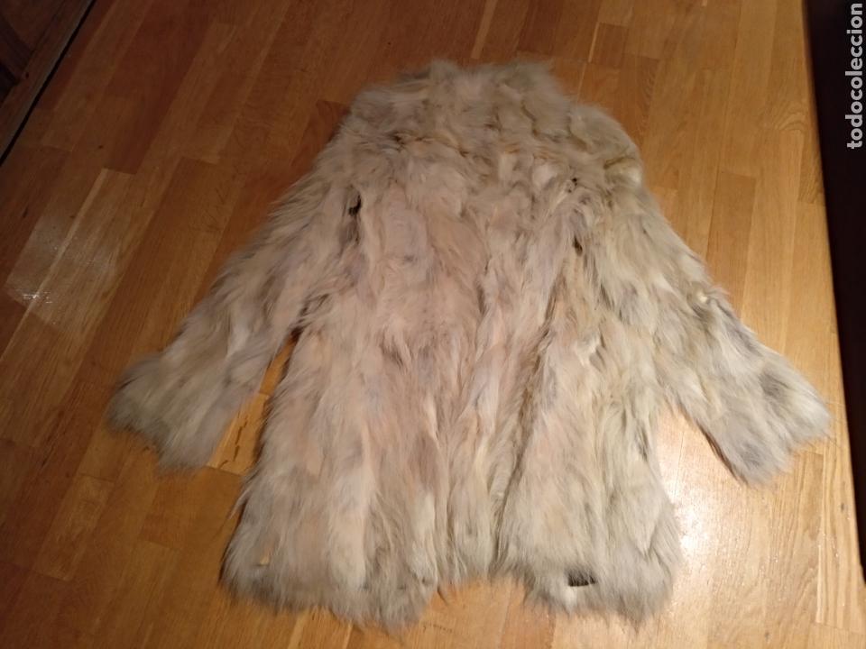 Abrigo lobo blanco