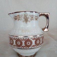 Antigüedades: LECHERA DE PORCELANA EN BASE DE PLATA.. Lote 130743664
