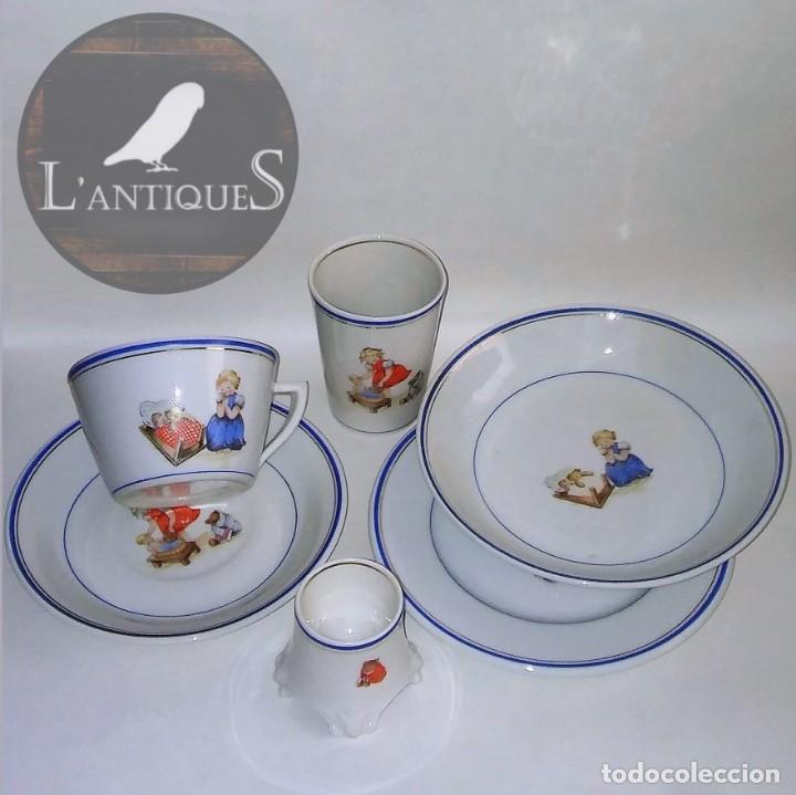 Antigua vajilla infantil en porcelana, (platos taza vaso huevera) dibujos de niña y juguetes pps XX segunda mano