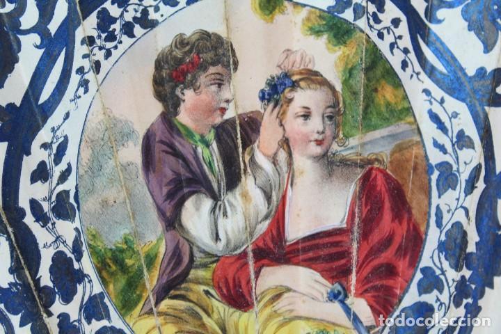 Antigüedades: Precioso abanico s XIX litografía y pintado a mano, coloreado a mano. A dos escenas, dos caras. - Foto 7 - 137826922