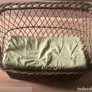Sofa baul de mimbre con cojín 100x50 cm.
