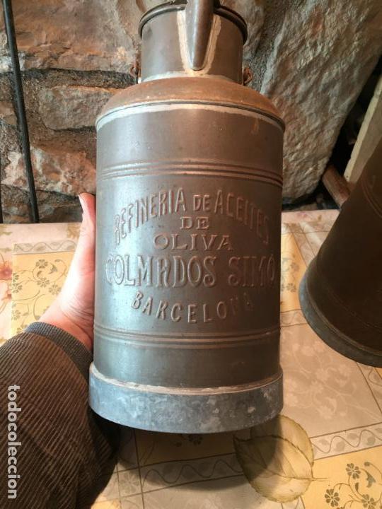 Antigüedades: Antiguos aceitera / aceiteras de lata refineria de aceites de Oliva Colmados Simó Barcelona - Foto 2 - 151331354