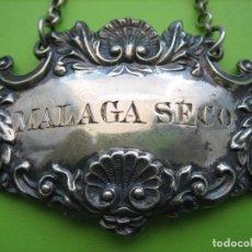 Antigüedades: ANTIGUA CHAPA PARA BOTELLA DE MALAGA SECO EN PLATA. CHAPA DE 6X4 CM. Lote 159794490