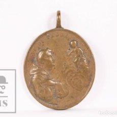 Antigüedades: ANTIGUA MEDALLA RELIGIOSA DE BRONCE - SAN ANTONIO DE PADUA / SAN FRANCISCO DE ASÍS - FINALES S. XIX. Lote 163019642