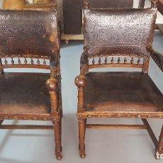 Antigüedades: PAREJA SILLONES NOGAL Y CUERO REPUJADO.. Lote 164656962