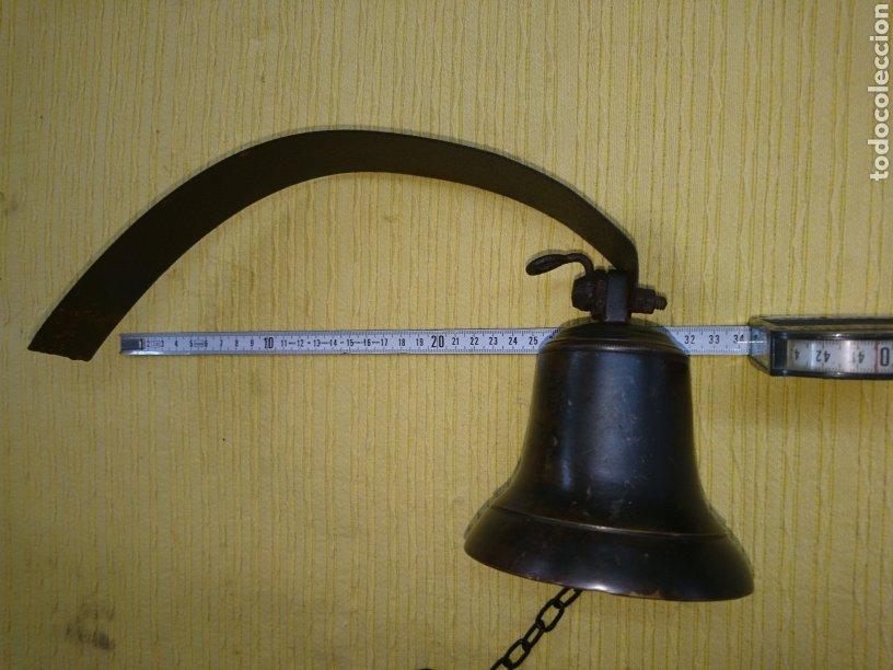 Antigüedades: CAMPANA ANTIGUA BRONCE 11cm DIAMETRO. CUELGA FLEJE FORJA. SONIDO SIN ROTOS NI GRIETAS ACUSTICAS. - Foto 13 - 186343653