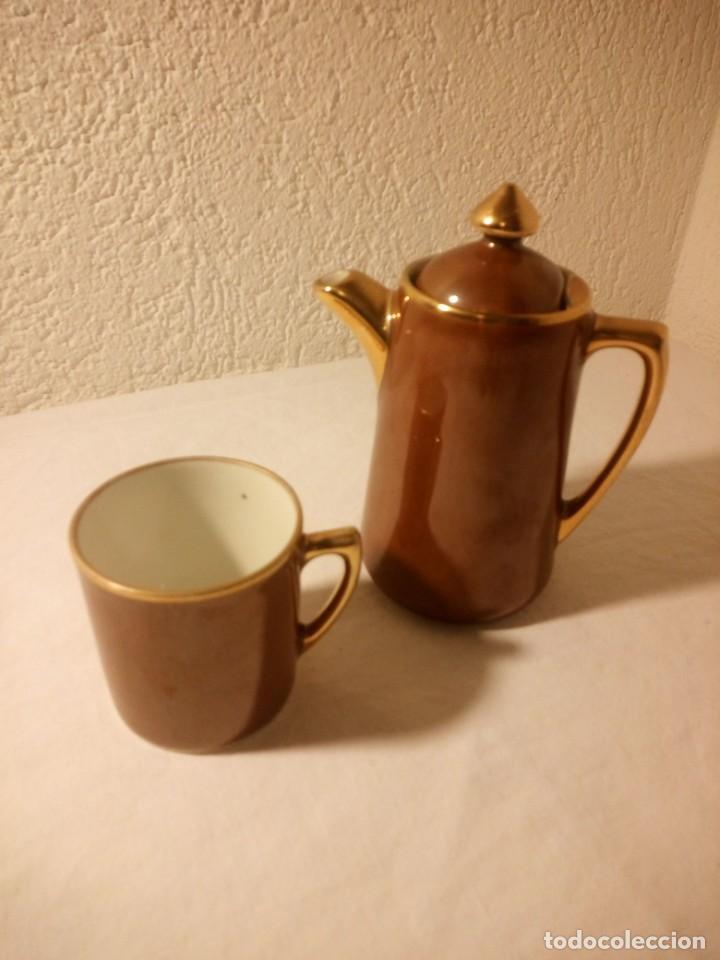 Antigüedades: Solitario de taza y cafetera de porcelana s.p.m. walkiire - Foto 2 - 189645653