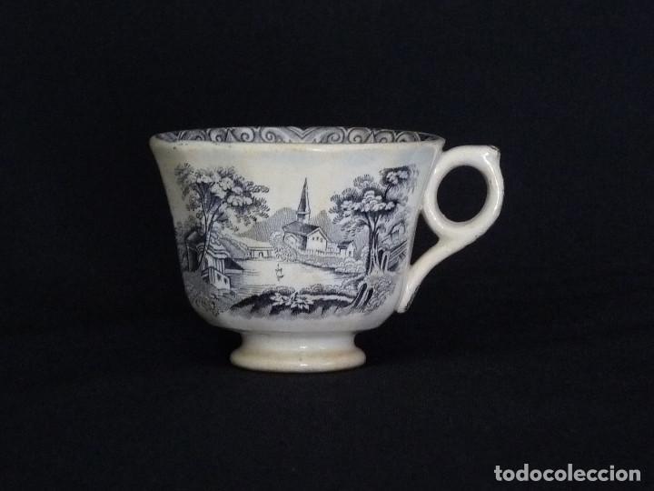 TAZA DE CAFÉ ESTAMPADA CON ¨IGLESIA ENTRE ARBOLES¨ Y ¨LA BARCA¨. (Antigüedades - Porcelanas y Cerámicas - Cartagena)