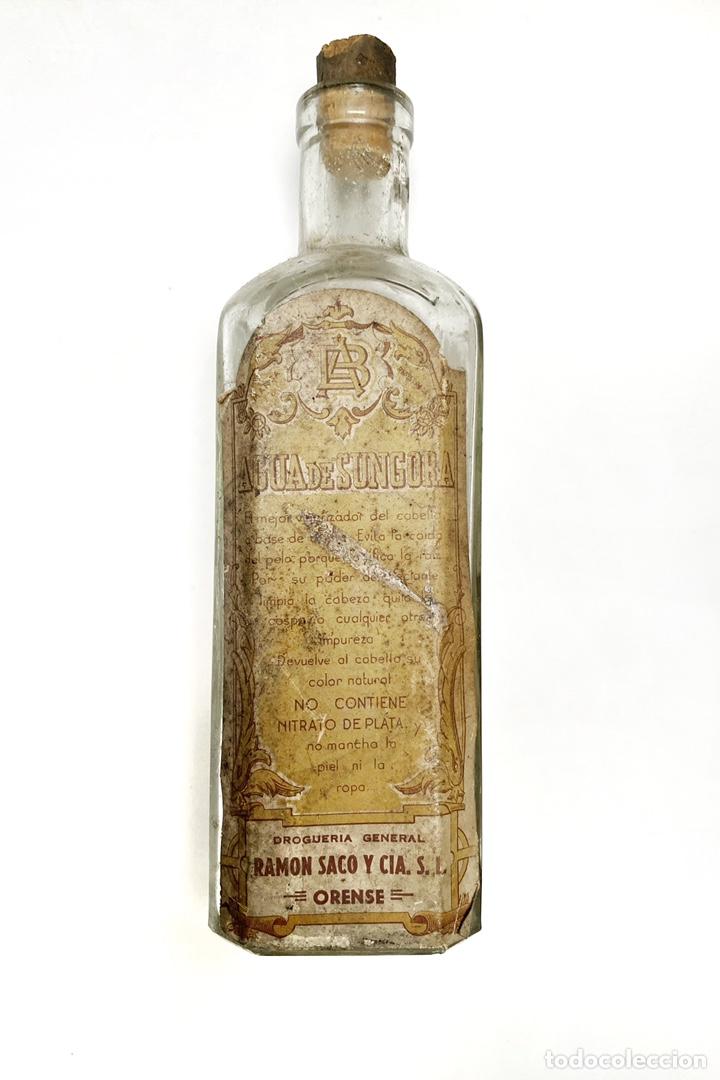ANTIGUA BOTELLA DE AGUA DE SUNGORA. VIGORIZADOR DE CABELLO. (Antigüedades - Cristal y Vidrio - Farmacia )