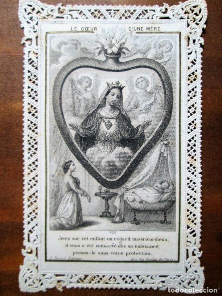 ANTIGUA ESTAMPA A PLUMILLA EN PAPEL TROQUELADO DEL SIGLO XIX EL CORAZON DE UNA MADRE (Antigüedades - Religiosas - Varios)