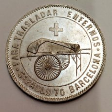 Oggetti Antichi: MEDALLA DE METAL-FABRICA DE COCHES Y SILLONES PARA TRASLADAR ENFERMOS. 3,8 CM.. Lote 280604293