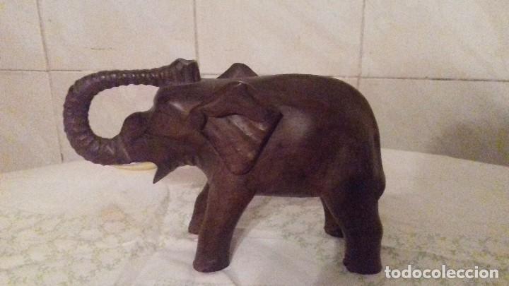 PRECIOSO ELEFANTE DE LA SUERTE TALLADO EN MADERA,LE FALTA UN COLMILLO. (Arte - Étnico - África)