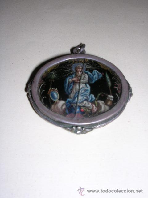 RELICARIO DE PLATA S.XVIII,CRISTAL PINTADO(ROTO VER FOTOS)POR EL OTRO LADO GRABADO CON DOS ANGELES (Arte - Arte Religioso - Grabados)