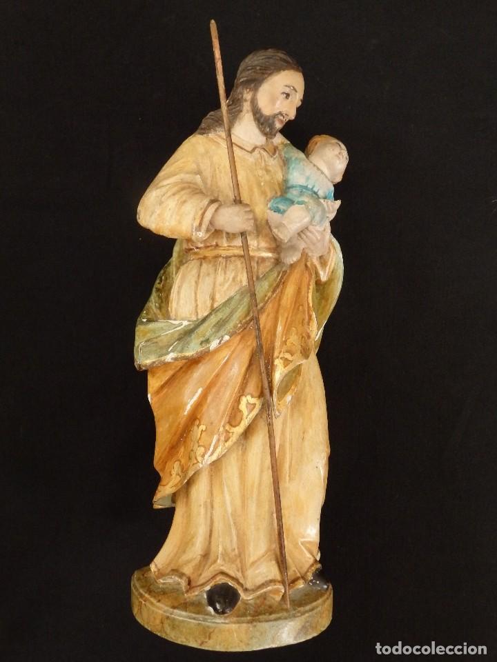 SAN JOSÉ CON EL NIÑO JESÚS. MADERA TALLADA Y POLICROMADA. 28 CM. HACIA 1900. (Arte - Arte Religioso - Escultura)