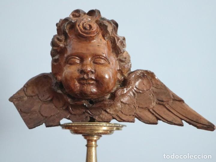 ÁNGEL ALADO ELABORADO EN MADERA TALLADA EN SU COLOR. S. XVIII. MEDIDAS DE 32 X 17 CM. (Arte - Arte Religioso - Escultura)